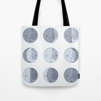 moon phases Tote Bags featuring Moon Phases by Katie Boland