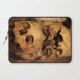 Skulls in the catacombs in Paris, France. Laptop Sleeve