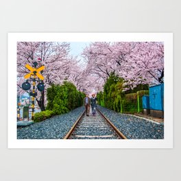 Walking under the blossoms Art Print