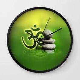 OM symbol  with zen stones on gentle green Wall Clock