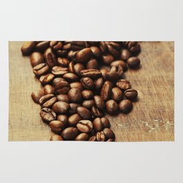Coffee beans on wooden background Rug