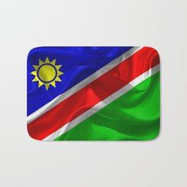 Waving fabric national flag of Namibia Bath Mat