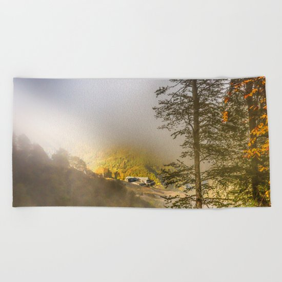 Mountains in the mist Beach Towel
