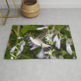 Hovering hummingbird with Hosta 38 Rug