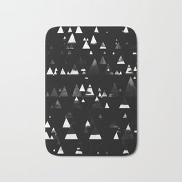 Faded white triangles pine forest on black Bath Mat