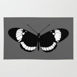 depress butterfly Rug