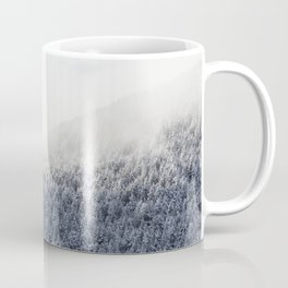 Pine trees on the snowy mountain Coffee Mug
