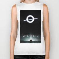 interstellar Biker Tanks featuring INTERSTELLAR by Tony Vazquez
