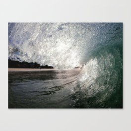 Ocean Wave at the Beach Illuminated by the Sun breaking over the viewers head. Canvas Print
