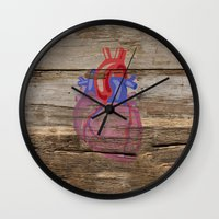 anatomical heart Wall Clocks featuring Anatomical Heart by Kyle Phillips
