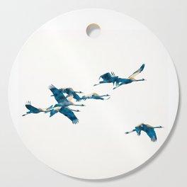 Beautiful Cranes in white background Cutting Board