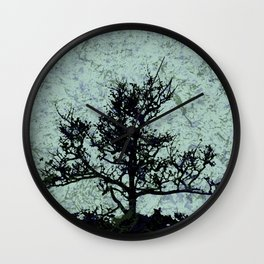 Tree Silhouette - blue marble-effect background Wall Clock