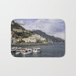 Amalfi, Italy- a view of the city, harbor and shoreline Bath Mat