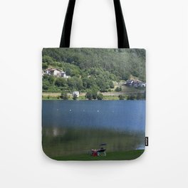 Scenic view of the Lake of Piazze with sun-bathing tourist Tote Bag