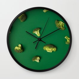 Colorful pattern of Broccoli on a green background Wall Clock