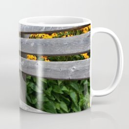 Seat in the park with yellow flowers Coffee Mug