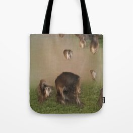 dogs on a grassy plain Tote Bag