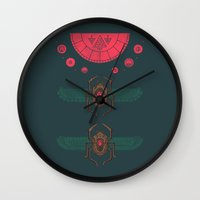 stargate Wall Clocks featuring Scarabs by Hector Mansilla
