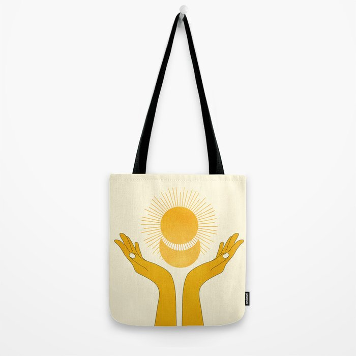 Holding the Light Tote Bag