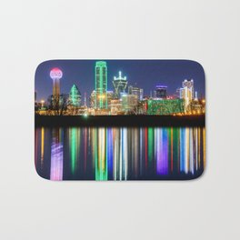 A very colorful Dallas Skyline with an impressive reflection Bath Mat