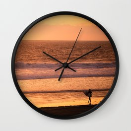 Surfer watching sunset in Southern California Wall Clock