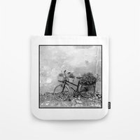 bike Tote Bags featuring Bike by a bicycle on the roof
