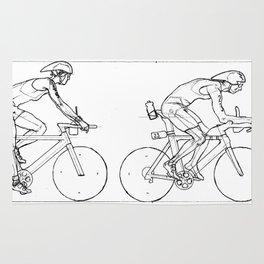 Transitions through Triathlon Cyclists Drawing A Rug