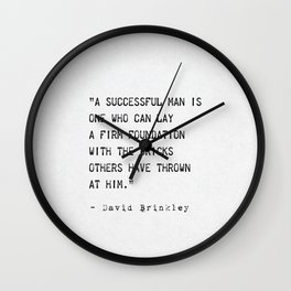 """A successful man is one who can lay a firm foundation with the bricks others have thrown at him."""" Wall Clock"""