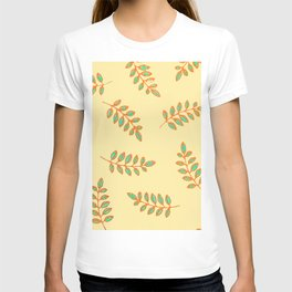 Speckled Leaf Prints in orange, teal blue on pale yellow T-shirt
