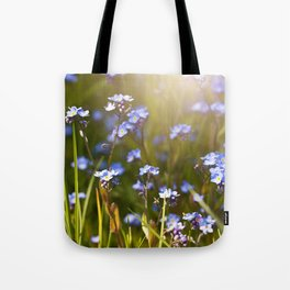 Forget me not flowers in sunlight Tote Bag