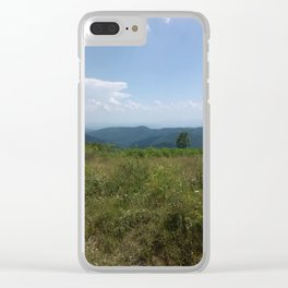 Meadow and mountains in the distance Clear iPhone Case