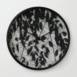 Grey shadows of green leaves Wall Clock