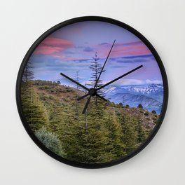 "Lenticular clouds over the mountains ""Mountain light"". Wall Clock"