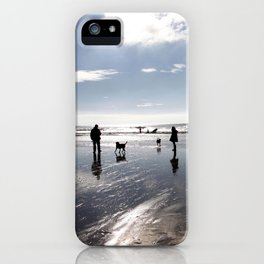 Dog walking on Caswell beach, Swansea in winter iPhone Case