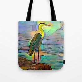 Grey heron on coast of ocean Tote Bag