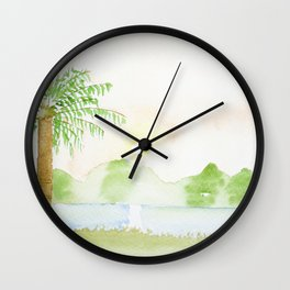 Palm tree in a sunset Wall Clock