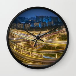 Busy interchange at night in China Wall Clock