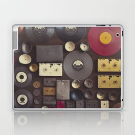Music. Vintage wall with vinyl records and audio cassettes hung. Laptop & iPad Skin