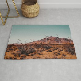 Wind turbine in the desert with mountain view at Kern County California USA Rug