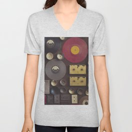 Music. Vintage wall with vinyl records and audio cassettes hung. Unisex V-Neck