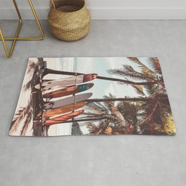 Surfboard and palm tree on summer beach. Travel adventure sport and summer vacation concept. Vintage tone filter effect color style. Rug