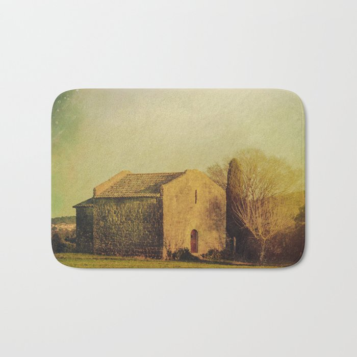 A cute small stone house without windows Bath Mat