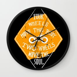 4 wheels move the body - 2 wheels move the soul Wall Clock