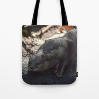 otters Tote Bags featuring otters in the woods by Claes Touber
