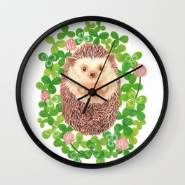 hedgehog in a field of clover Wall Clock