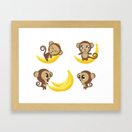 Monkeys with banana Framed Art Print