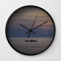rowing Wall Clocks featuring Rowing into the sunset II by Maria Heyens