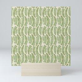 Palm leaves in tiger print Mini Art Print