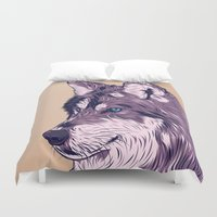 wolf Duvet Covers featuring Blue eyed wolf by Roland Banrevi