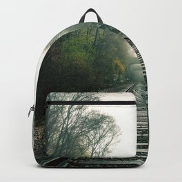 Creepy foggy railroad Backpack
